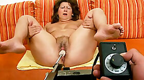 Fat cougar chick is testing a new sex machine with legs open