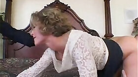 Beautiful MILF using a dildo on her tits